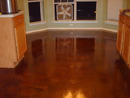 photos of concrete epoxy floors | Removed the linoleum floor before  applying a troweled overlay.