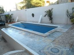 swimming pool beach entry fiberglass pools fibreglass how much does a cost real world examples