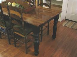 diy farmhouse dining table with oak wooden top and legs painted with black color plus antique ladder dining chairs with high back on hardwood floor tiles