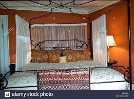 Antique four poster bed with canopy and sheer curtains in showcase ...