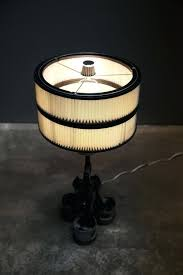 piston lamp this lamp can be made with a touch dimmer switch so you can touch anywhere on the lamp to turn it on or off piston lamp table lamprey poisonous