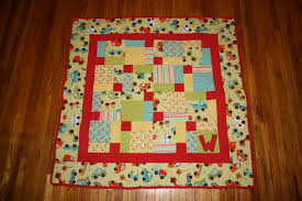 Two Disappearing Nine-Patch Baby Quilts | nesting squared & Image Adamdwight.com