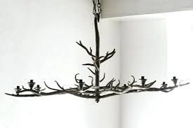 tree chandelier large tree branch shaped chandelier of formed steel with patina finish this artist palm