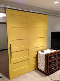 yellow barn door by calgary interior designer