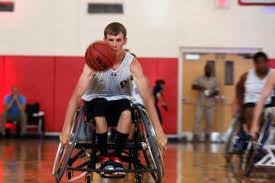 u s department of defense photo essay u s army spc terry cartwright dribbles toward the basket for a shot during a wheelchair
