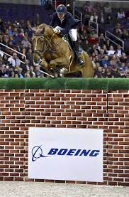 Jos Verlooy and Sunshine in the Puissance. (©Alden Corrigan) | Equestrian  jumping, Horse rider, Horse jumping