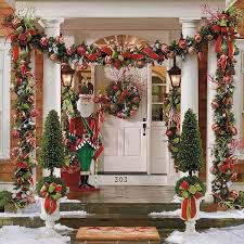 Outdoor Christmas Decoration Ideas - Colorful Garlands with Santa - Click  Pic for 20 Front Porch Christmas Decorating Ideas Very full! But still  pretty!