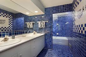 blue bathroom tile ideas: this bathroom is covered in deep blue tiles with pristine white grout on the wall