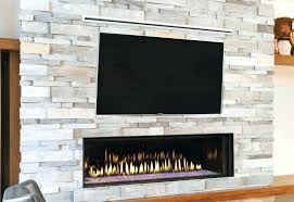 hanging tv over fireplace