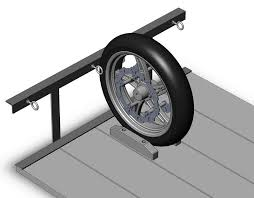 run the front wheel between the two 2x3 s bolted thru the floor lash the front wheel between the two close eye bolts and tie down the lower triple between