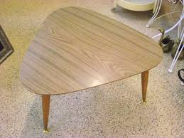 a mid century modern triangle guitar pick peg leg formica top coffee table