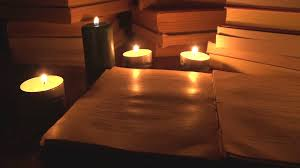old book candlelight candle night open reading doent research stock video fooe videoblocks