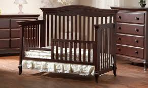 image of wood crib that turns into toddler bed