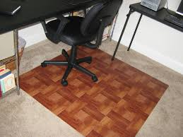 bamboo office floor mats under black leather wheeled chair and small office table in minimalist office design