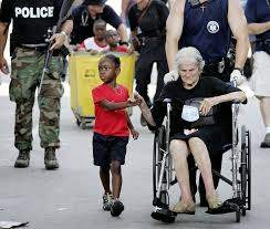best jour photo essay hurricane katrina by mitchell tanisha blevin holds the hand of fellow hurricane katrina victim nita lagarde 105 as they are evacuated from the convention center in new of the most