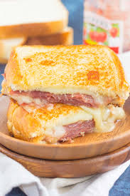 with fresh slices of prosciutto raspberry jam brie and mozzarella cheeses grilled until golden and melty this sandwich is the perfect comfort dish