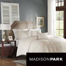 create a neutral look to bedroom space with the madison park nia four piece cover set this beautiful set is made from cotton chambray with pintucking