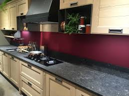black marbe countertop with a red wall for backsplash