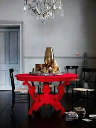take a look at this grey dining room with bold red table from livingetc for inspiration for more dining room ideas such as how to