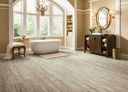a bathroom with a vinyl tile from armstrong that looks like travertine