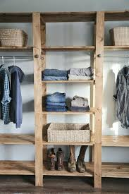 diy wood closet shelves white build a industrial style wood slat closet system with galvanized pipes