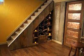 great wine cellar under stair basement underground kitchen stairs glass staircase