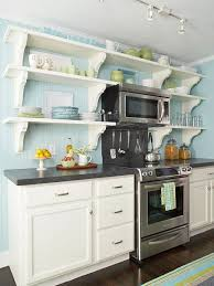 wide light blue beadboard backsplash and wall cover to make white shelves stand out