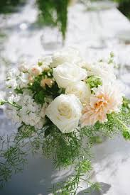 for a beautiful spring or early summer wedding group together complementary peach and white colors sprinkle in greens and baby s breath to round out the