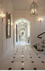 black and white marble floor with the white walls and trim work- perfectly  timeless.