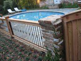Decorative Pool Fence Ornamental Iron Fence With Wood Posts Adds An Organic Touch And