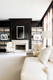 if your favorite thing is curling up with a good book you ll love this living room that features a cozy fireplace and tall bookshelves