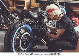 calm granny making motorcycle maintenance serene female stock