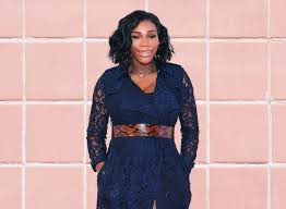 serena williams makeup tennis pro serena williams in a navy blue outfit on a background