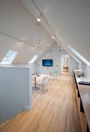 overhead track lighting. Track Lighting For Vaulted Ceilings Can Illuminate Entire Rooms With Minimal Obstruction And Oftentimes A Single Overhead I