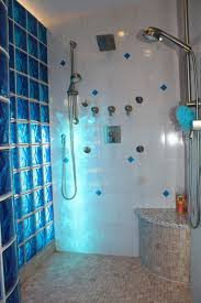 blue light streaming through sapphire colored glass block shower wall