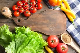 Wooden Board With Vegetables On Kitchen Table Cooking Classes