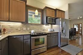 Contemporary Two Tone Kitchen Cabinets Design made from Wooden Material  Combined with White Kitchen Countertop for