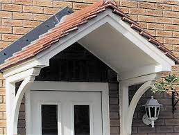 front door canopyA new door canopy will turn a house into a home Description from
