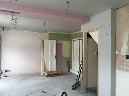building regulations dictate that the steel joist is wrapped in non flammable commercial plasterboard which is about 15mm thick explains jo buckerfield