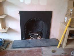 classic victorian fireplace with gas fire and cast iron insert
