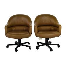 pair of brown leather office chairs used
