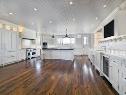 Eco Friendly Kitchen Flooring Elegant Kitchen Designed With Distressed Cabinets And Hardwood