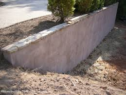 a simple solution to beautify a bare concrete retaining wall
