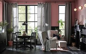 seating room furniture. A Living Room With Large Windows Is Decorated In Shades Of Black Mauve And Grey Seating Furniture O