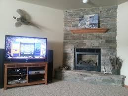 plan to stone around where tv will mount as others have stated technically you are not covering up rock as framing around it