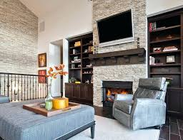 stone fireplace with tv stone accent wall living room transitional with above fireplace above fireplace high stone fireplace with tv tv wall