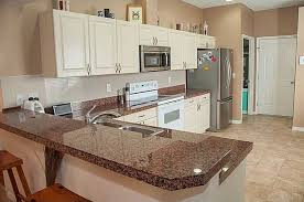 tan brown granite countertops with white cabinets