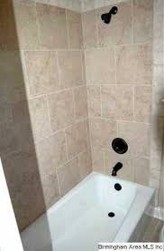 Cast iron tub, ceramic tile flooring and shower surrounds are also featured  in the upstairs bath.