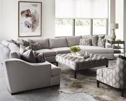 beautiful living room completed with grey sofa and tufted coffee table taylor king furniture