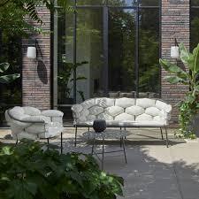 serpentine armchairs from designer